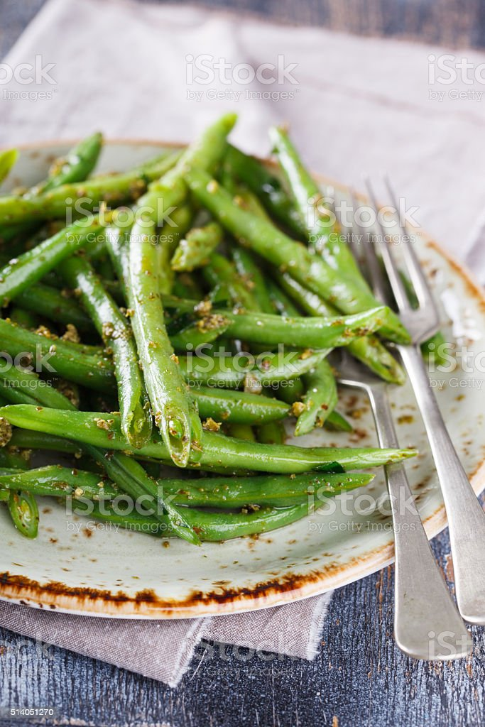 green salad green beans with pesto stock photo