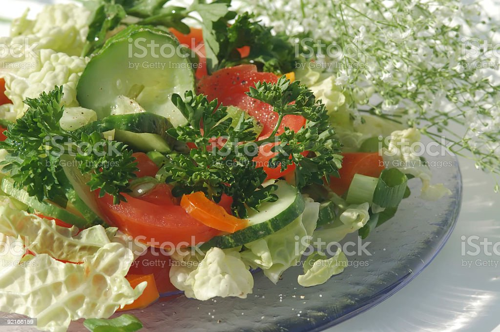 Green salad on a glass plate royalty-free stock photo