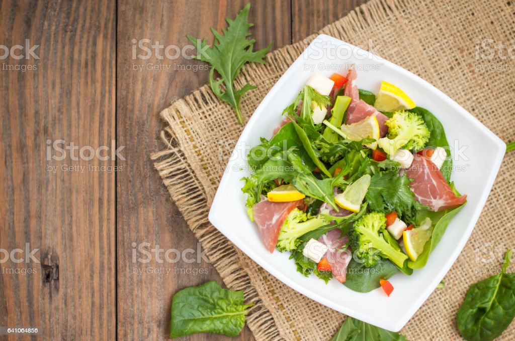 Green salad on rustic background. Wooden . Top view. Close-up stock photo