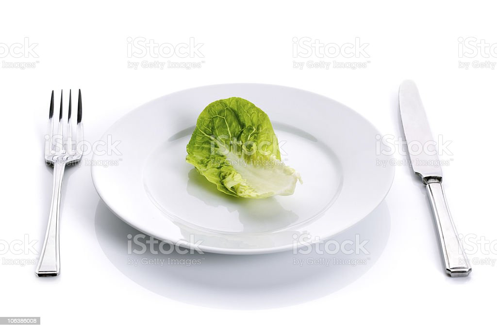 Green salad on white plate royalty-free stock photo