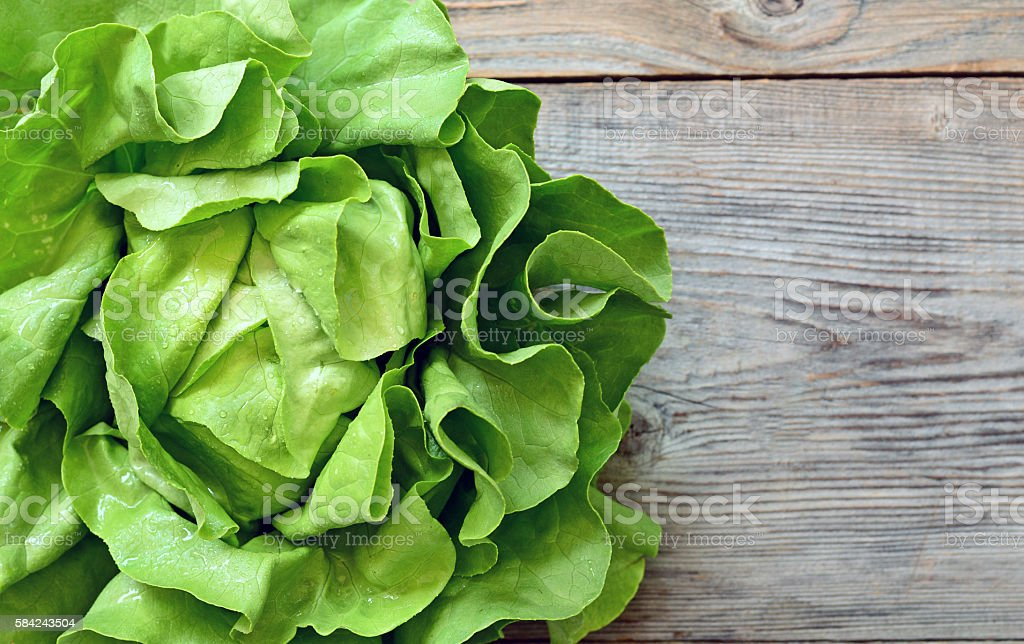 Green salad on wooden background stock photo