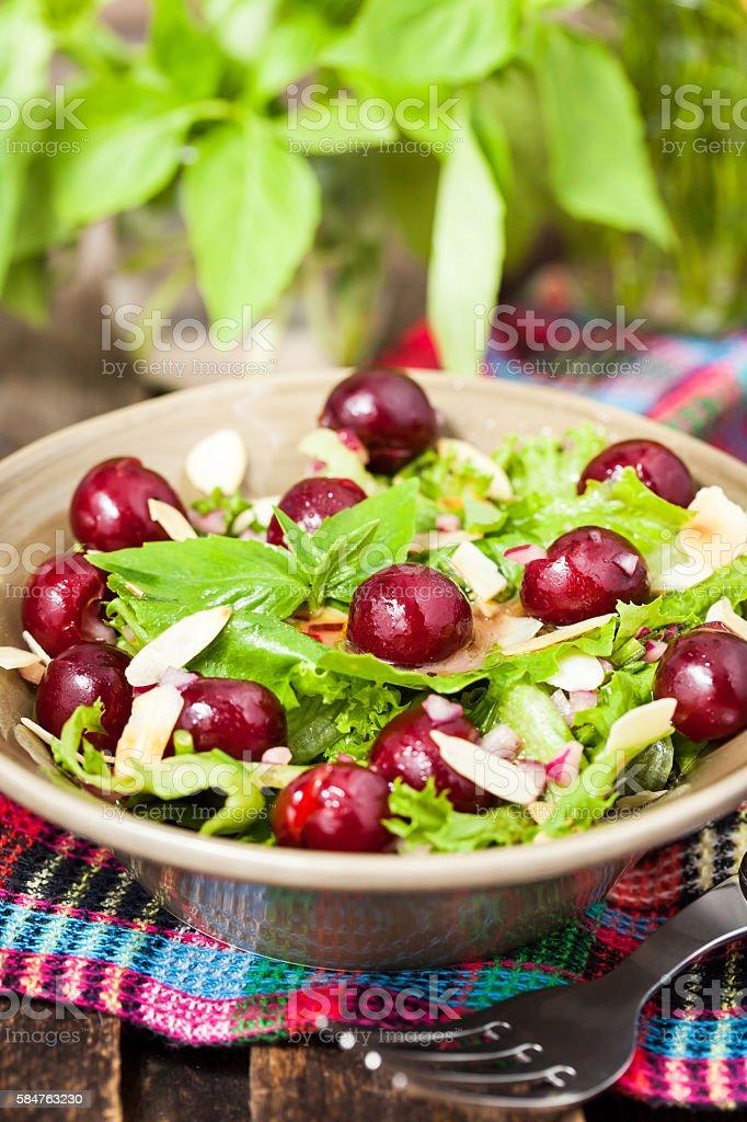 Green salad with fresh cherries stock photo