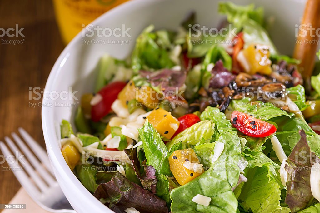 Green Salad with Quince Fruit stock photo