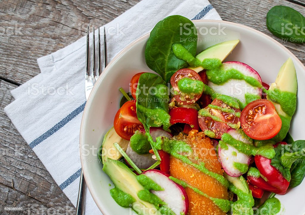Green salad with spinach, pesto, sweet potato stock photo