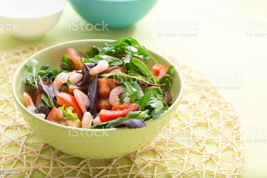 Green salad with tomatoes and shrimps stock photo