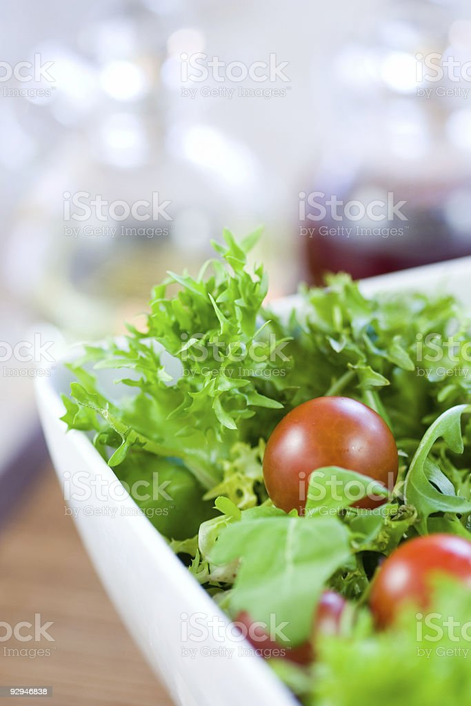 Green salad with tomatoes stock photo