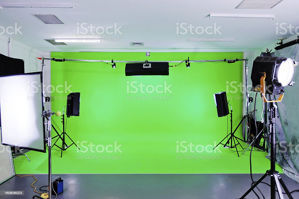 A green screen studio set up for filming stock photo