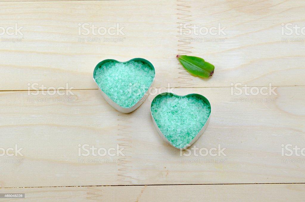Green sea salt  in a heart shaped box royalty-free stock photo