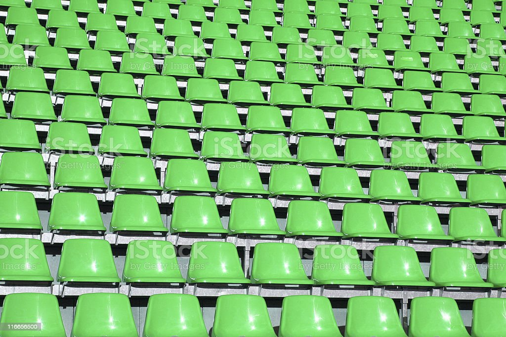 Green seats in a stadium royalty-free stock photo