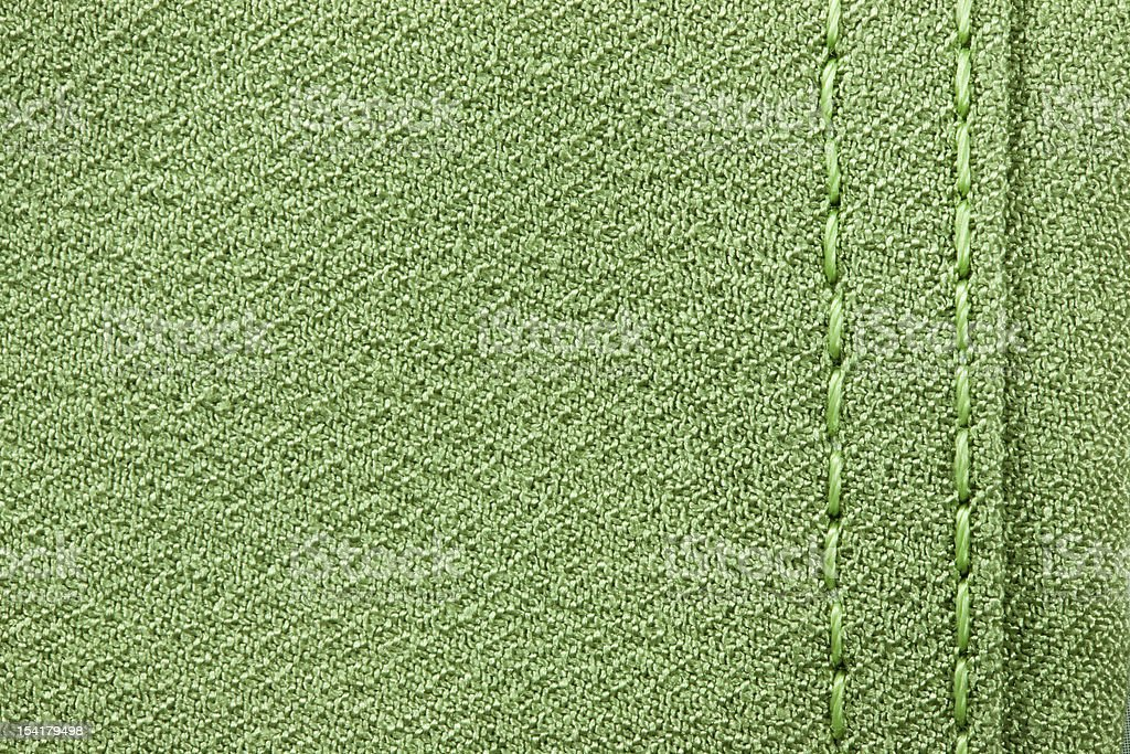 green sewing fabric texture stock photo