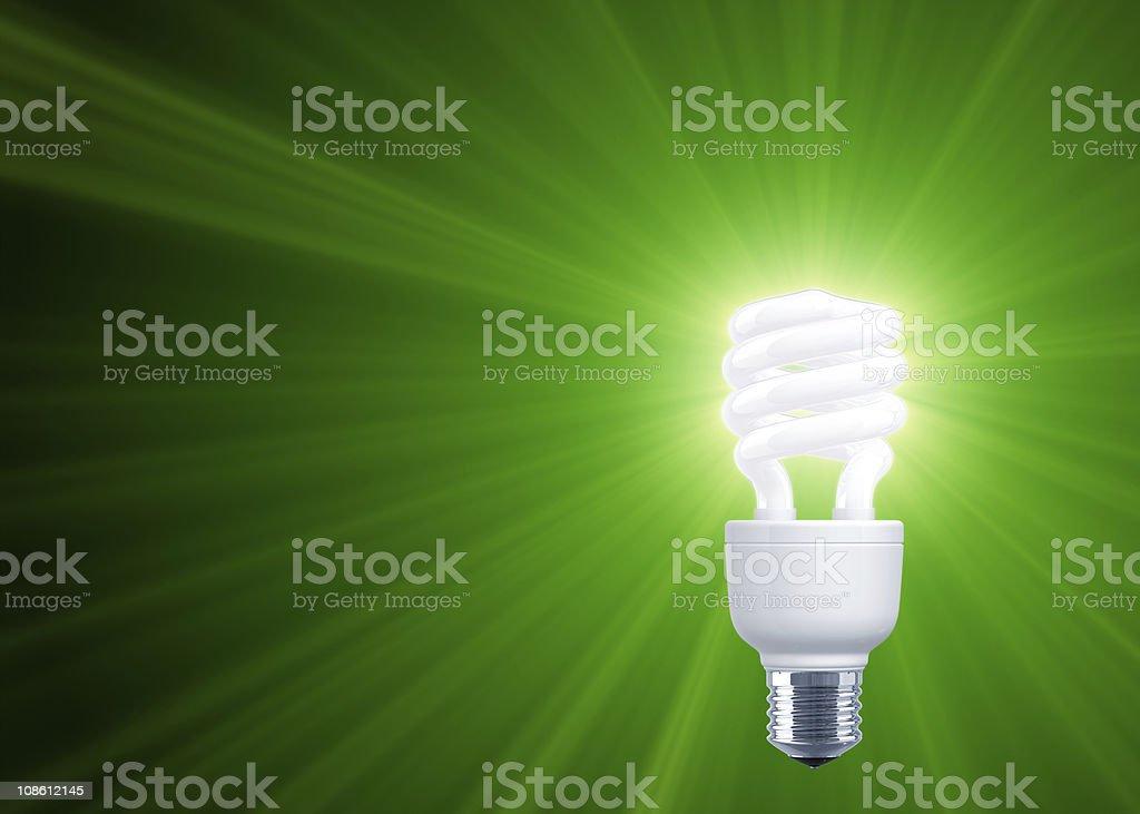Green Shine of Compact Fluorescent Light Bulb stock photo
