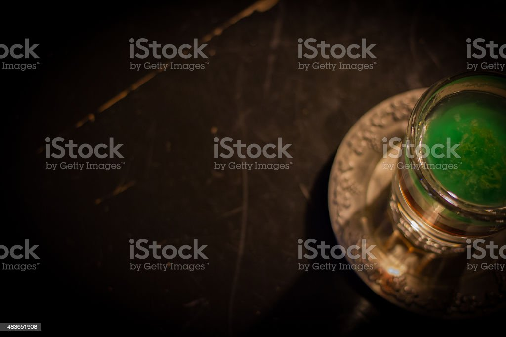 Green shot of absinthe on a wooden background in a bar stock photo