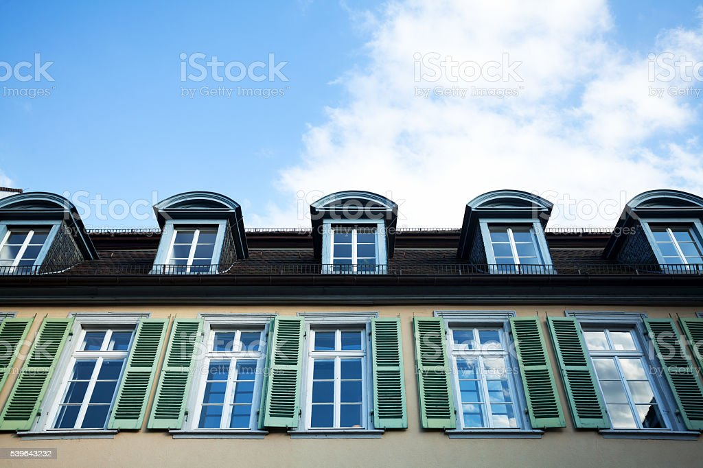 Green shutters and dormers of old house stock photo