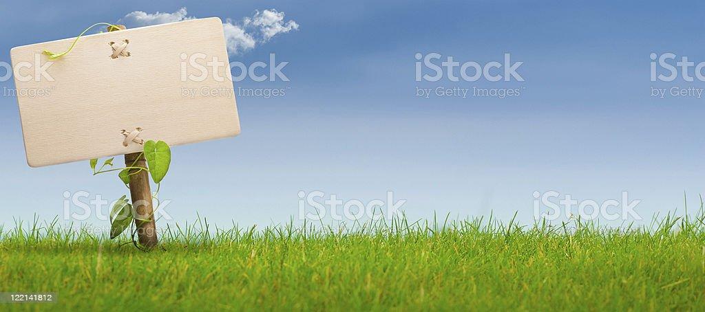 green sign, horizontal banner, blue sky stock photo