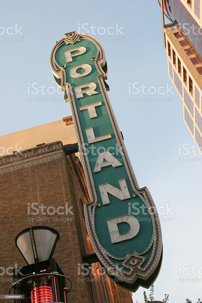Green sign of Portland spelled vertically in white stock photo