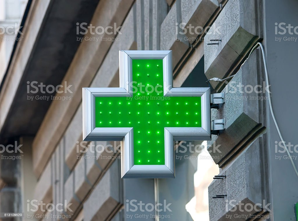 Green sign of the Red Cross stock photo