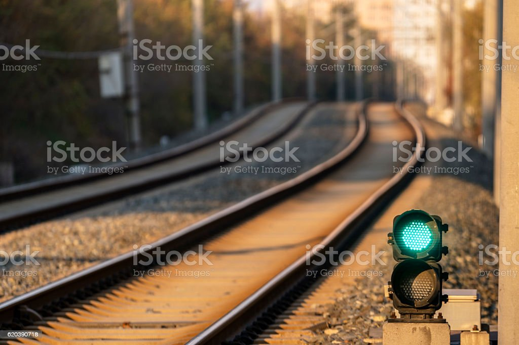 green signal light and railway track stock photo