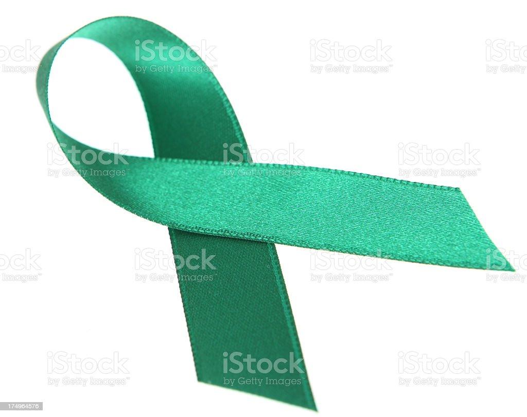 Green silk awareness ribbon on white background stock photo
