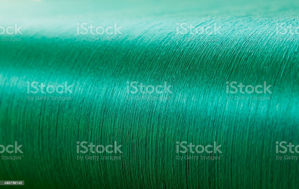 Green silk on a warping loom of a textile mill stock photo