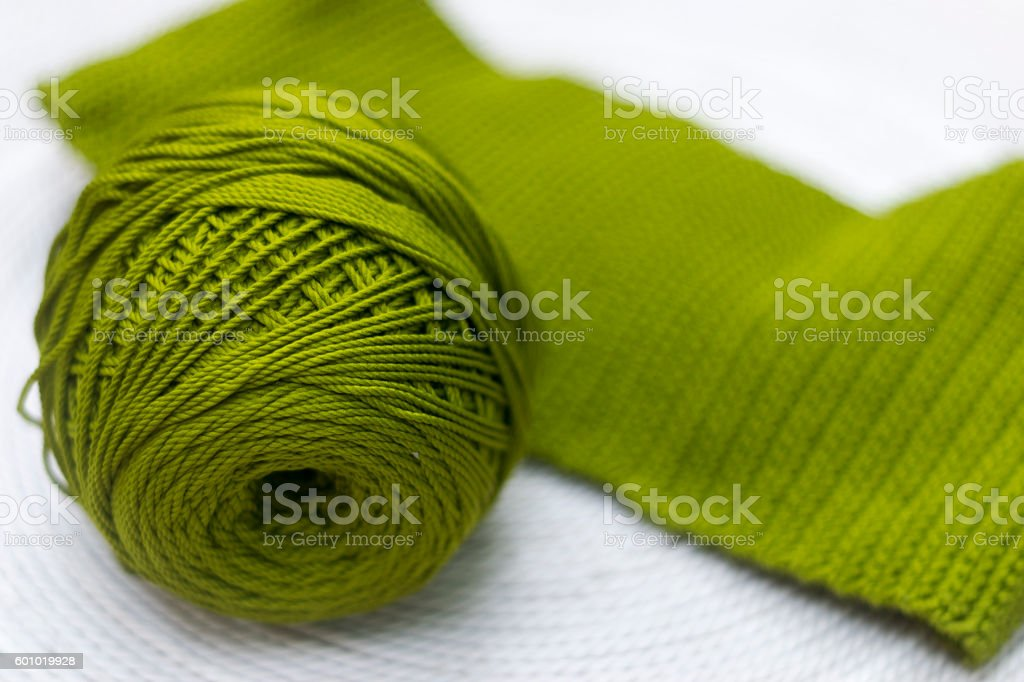 Green skein of wool with a knitted part stock photo
