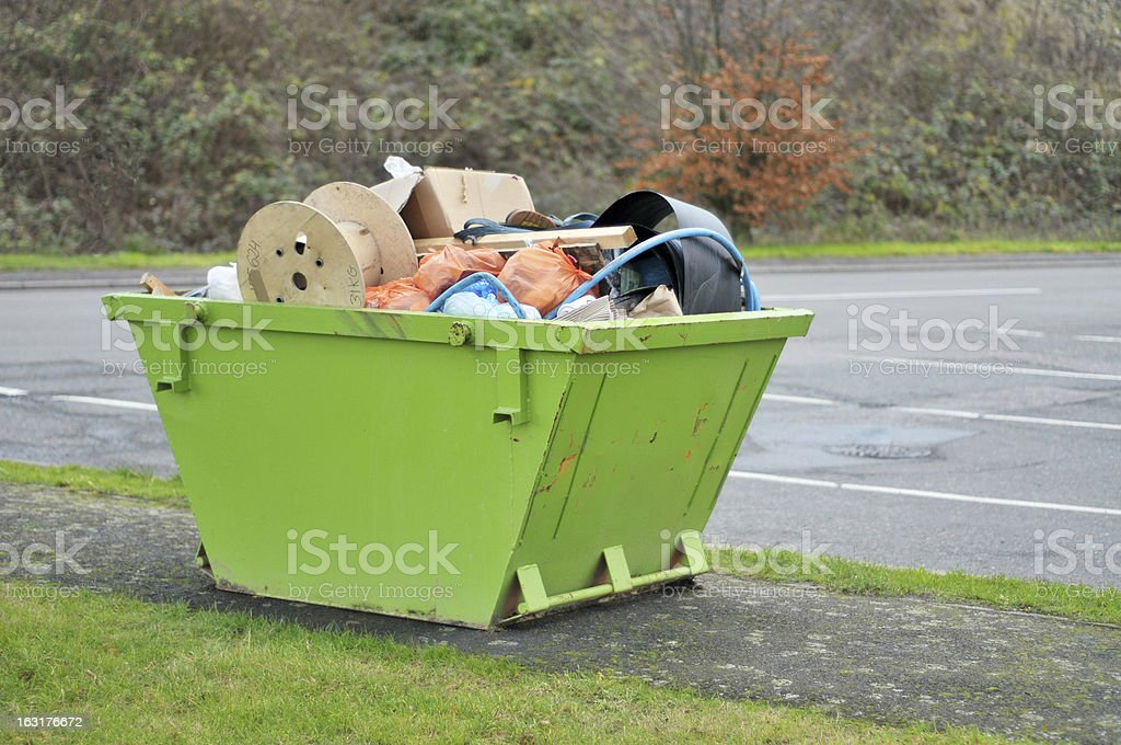 Green Skip Full Of Rubbish stock photo