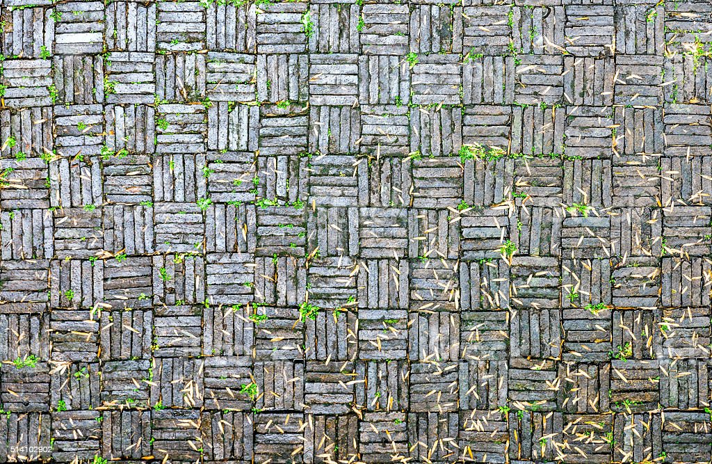 green slabstone  covered with bamboo leaves stock photo