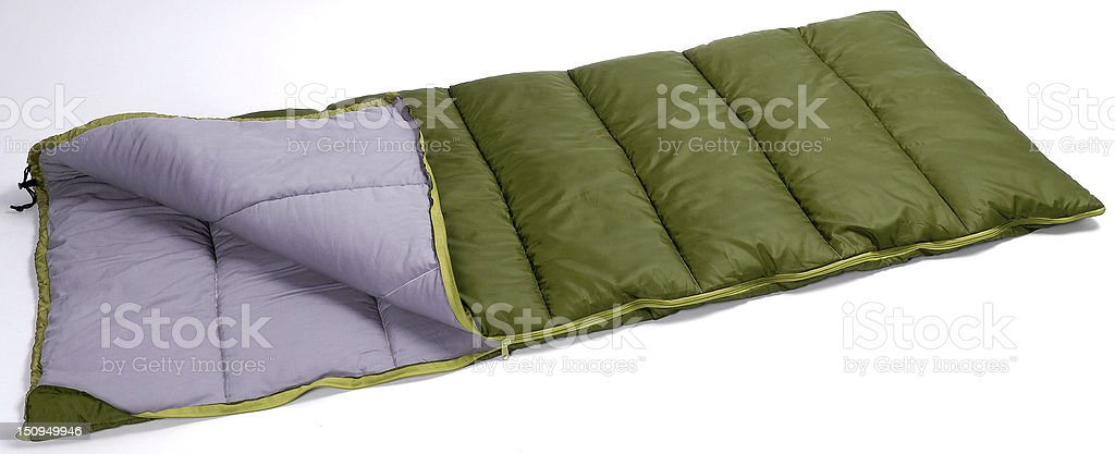 green sleeping bag stock photo