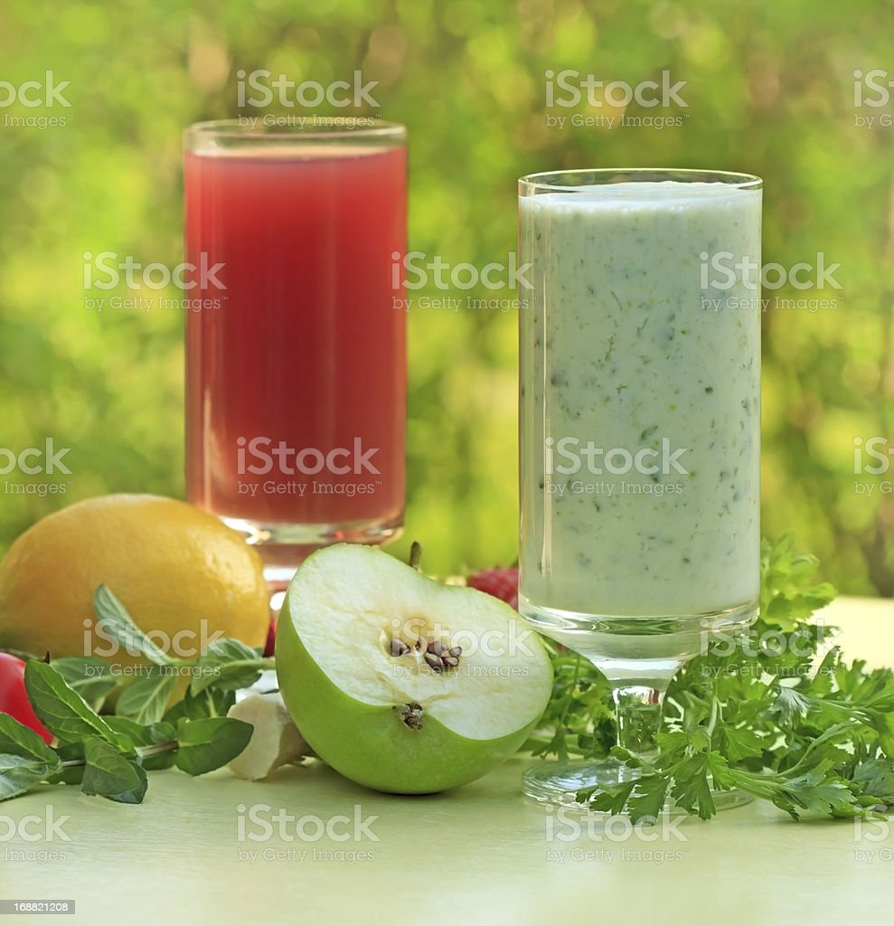 Green smoothie and strawberry juice royalty-free stock photo