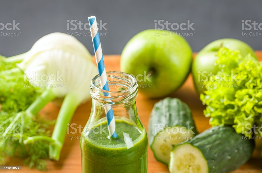 Green smoothie in a bottle with fresh fruits and vegetables stock photo