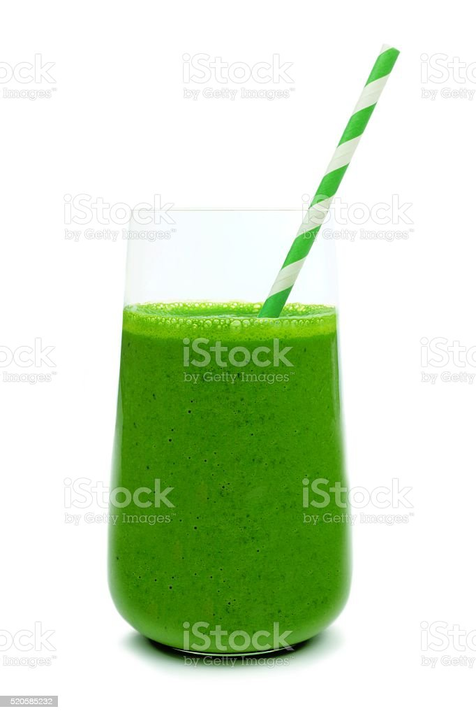 Green smoothie in a glass with paper straw isolated stock photo