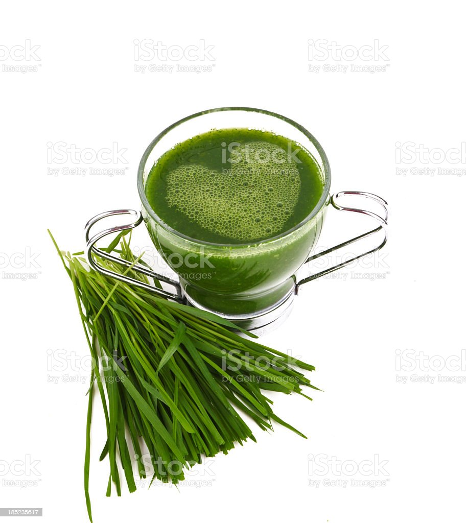 Green smoothie in glass mug with heart shaped froth stock photo