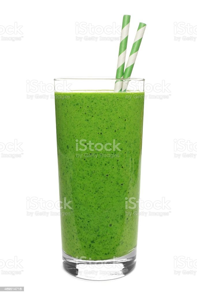 Green smoothie in glass with straws isolated on white stock photo