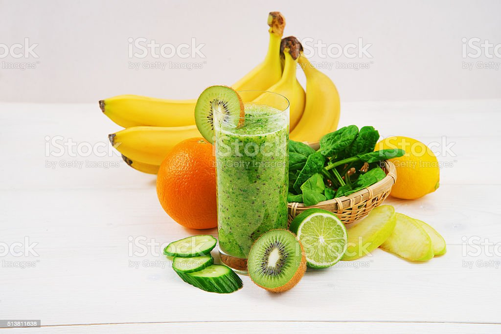 Green smoothie made with kiwi, spinach  and banana stock photo