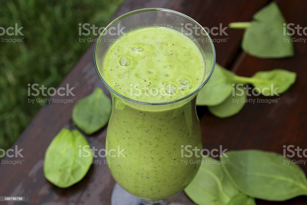 Green smoothie made with spinach and kiwi outdoor stock photo