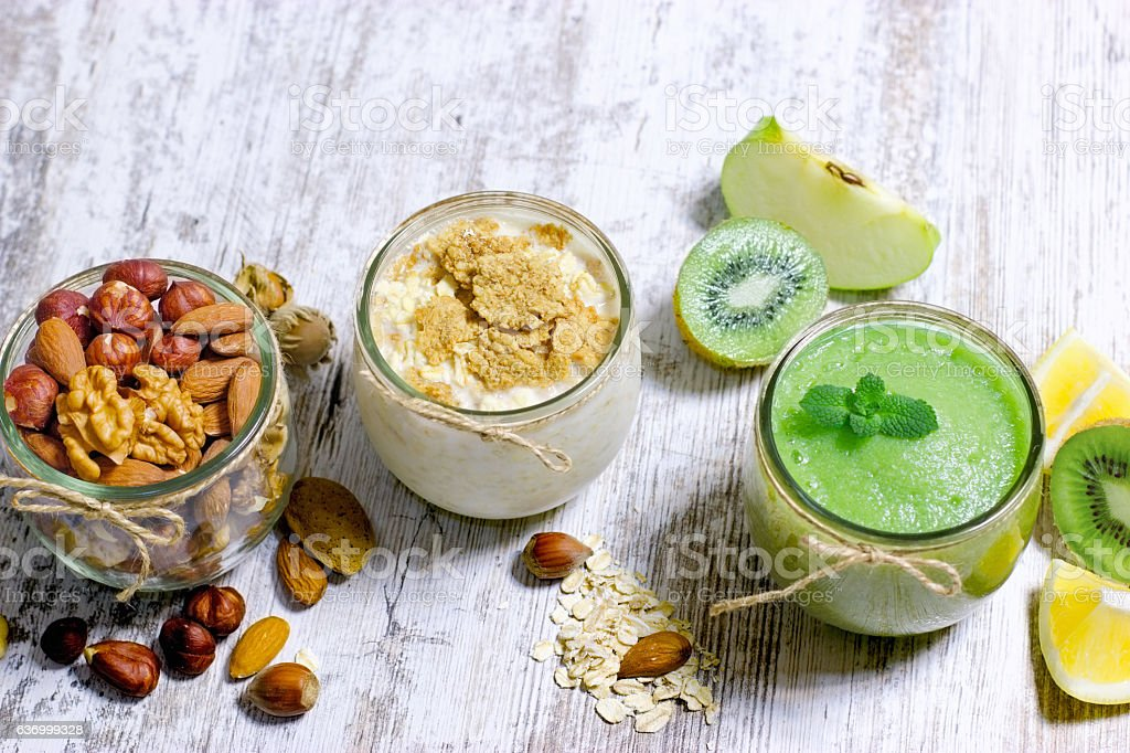 Green smoothie, oat meal and nuts stock photo