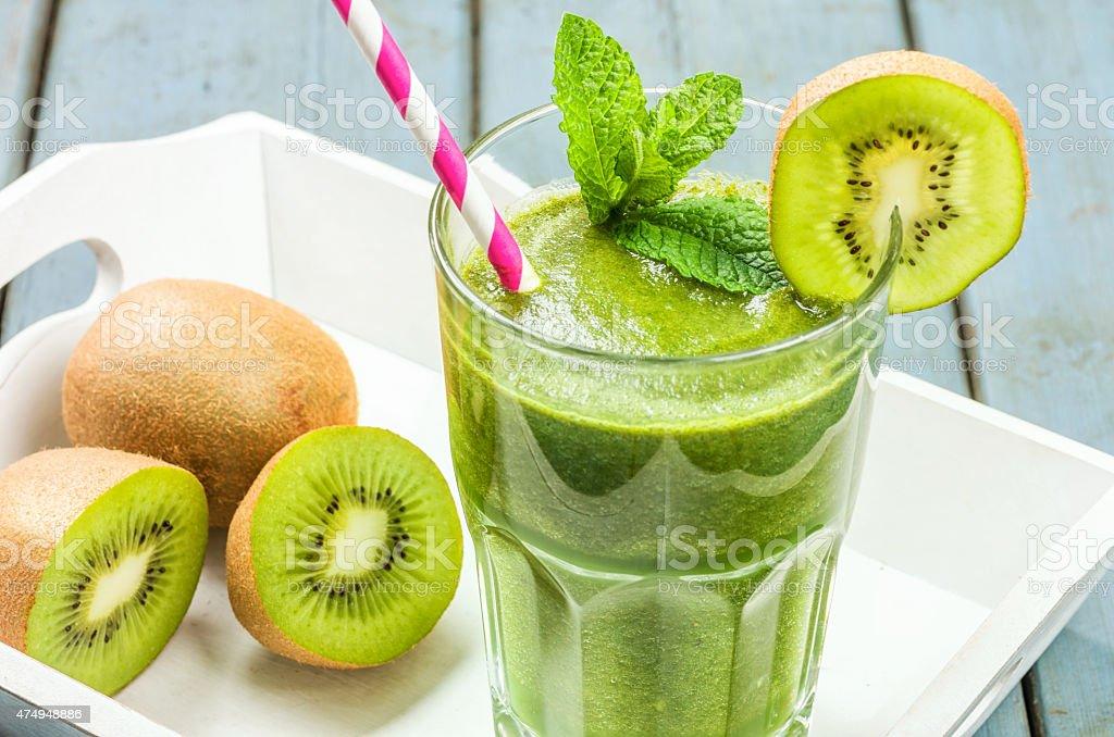Green smoothie on a tray with kiwi stock photo