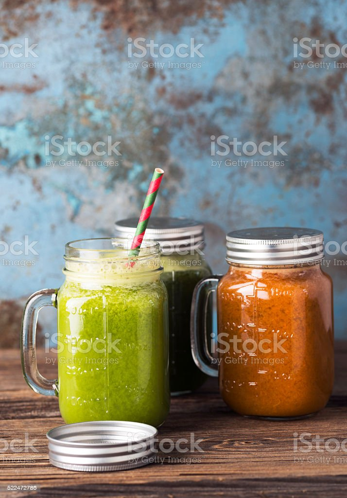 Green smoothie on wood background stock photo