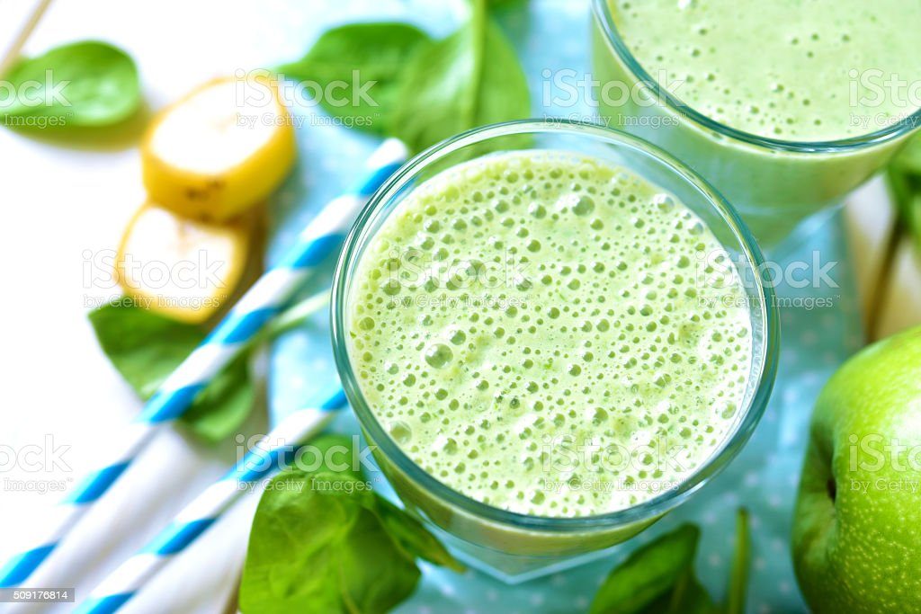 Green smoothie with apple,banana and spinach. stock photo