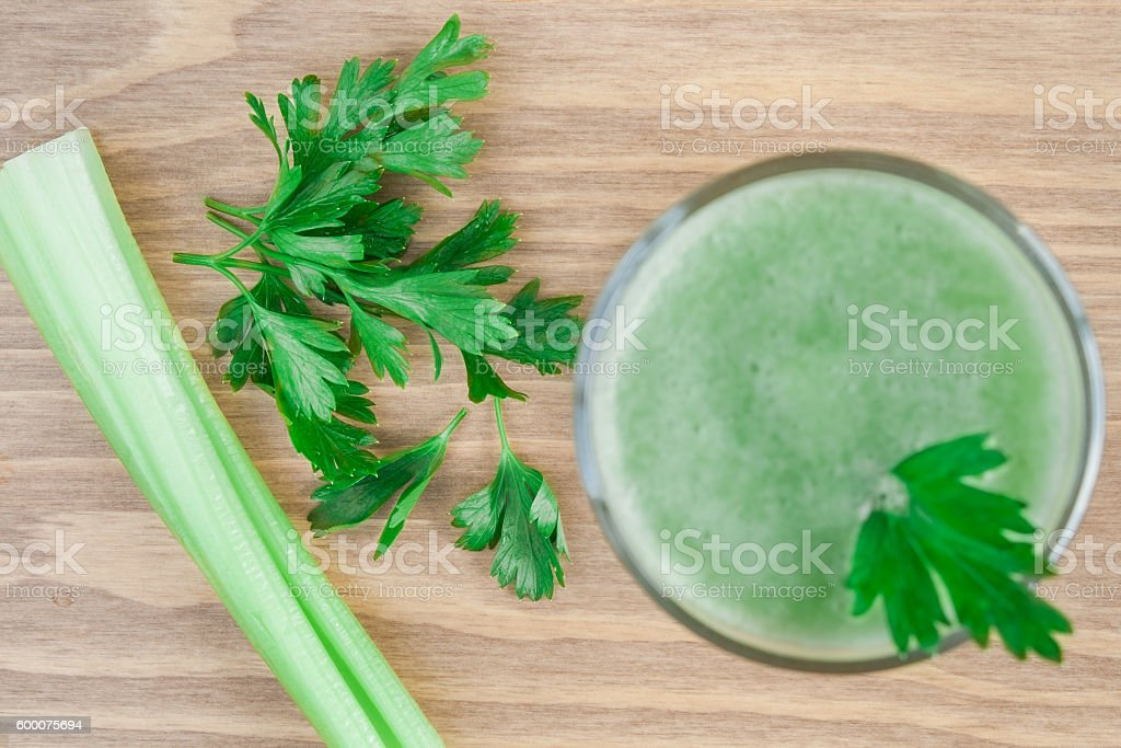 Green smoothie with celery and parsley. stock photo