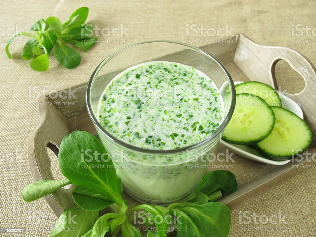 Green smoothie with corn salad and cucumber stock photo