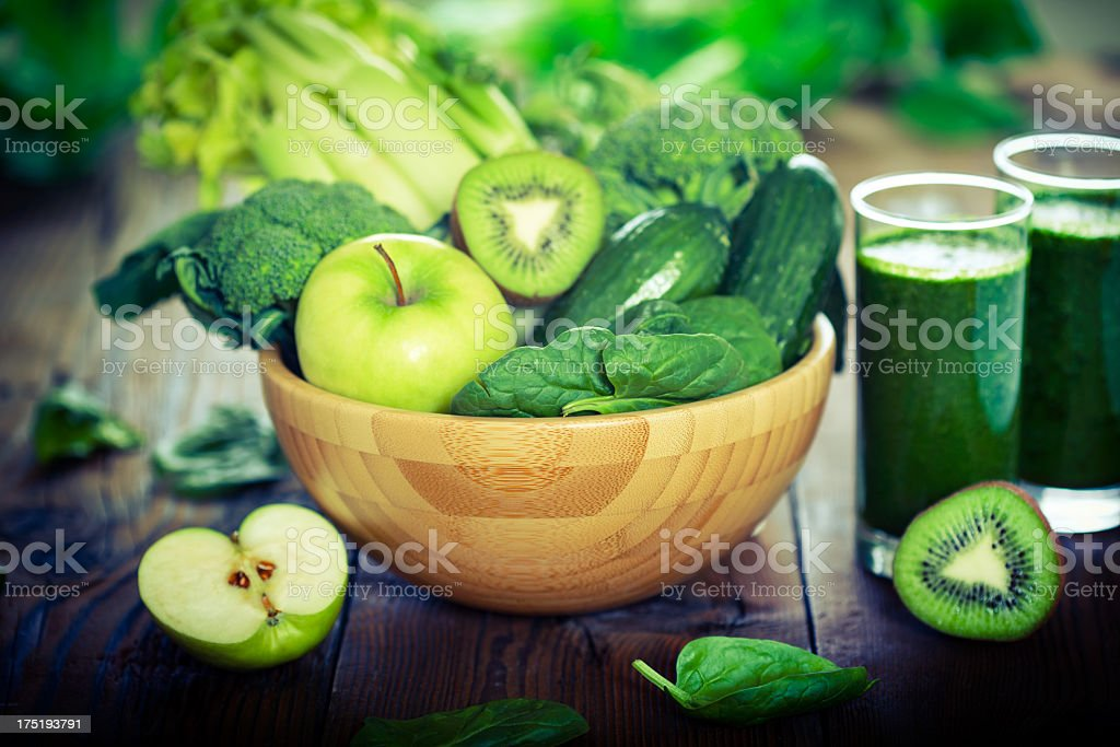 Green smoothie with fresh fruit and vegetable stock photo