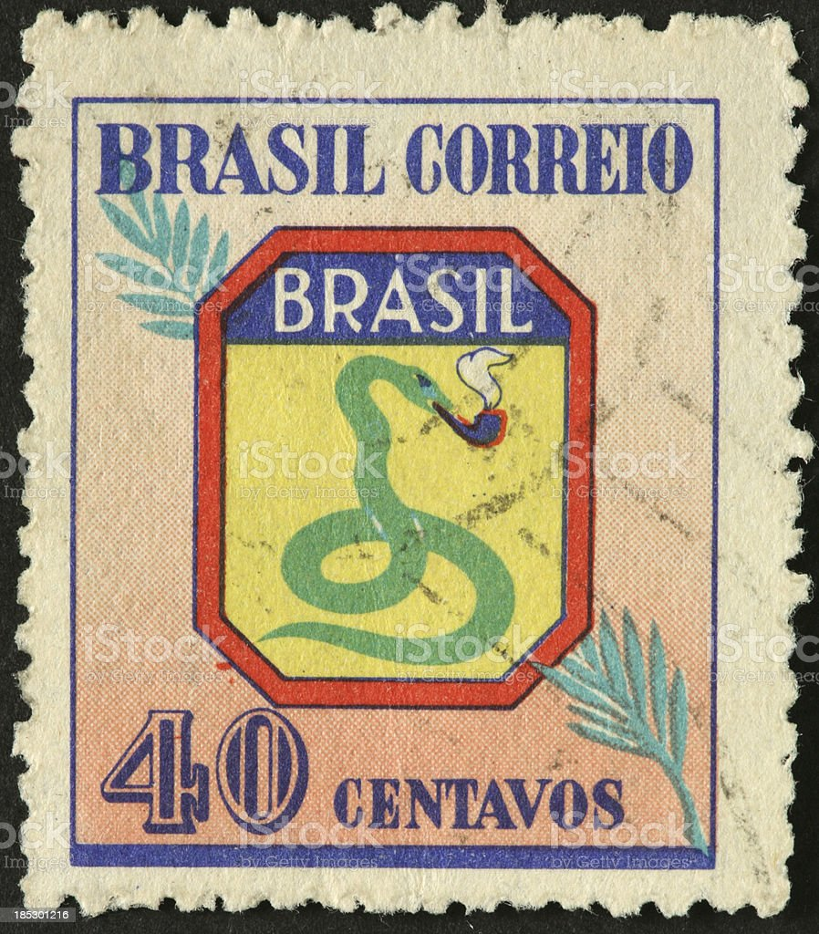 green snake smoking a pipe on Brazilian stamp royalty-free stock photo
