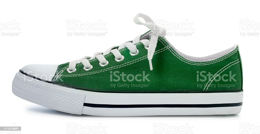 Green Sneaker on a White Background royalty-free stock photo