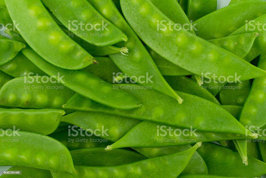 green snow pea pods background stock photo