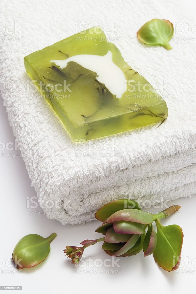 Green soap on white towel royalty-free stock photo