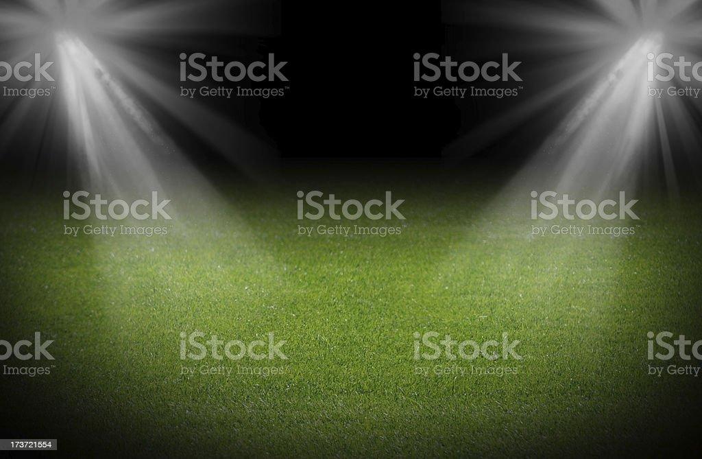 Green soccer field, bright spotlights, illuminated stadium stock photo