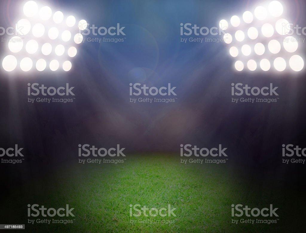 Green soccer field, bright spotlights stock photo