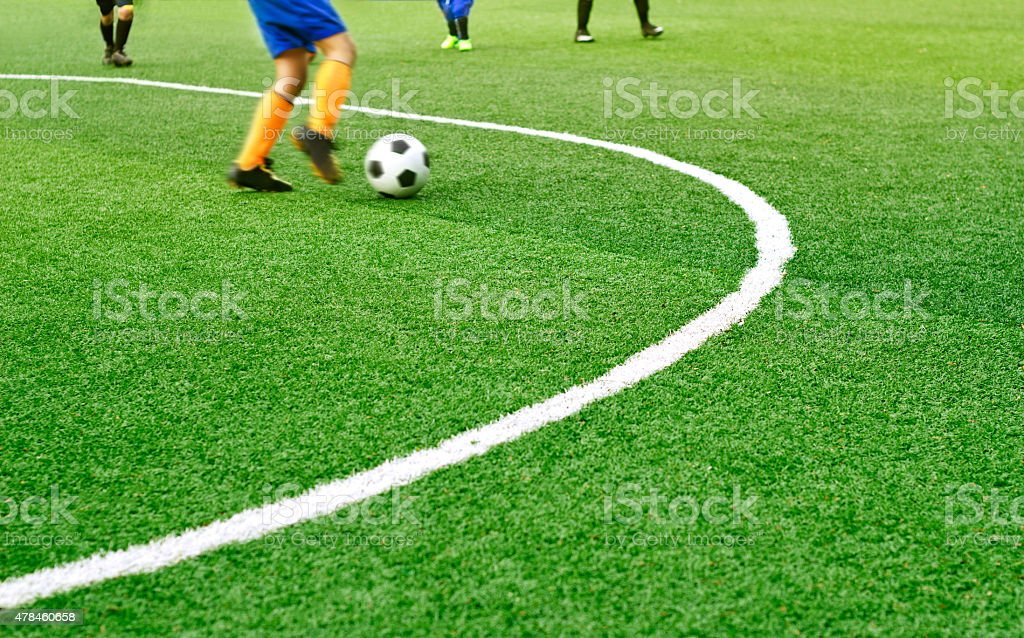 Green soccer field grass with white mark line stock photo