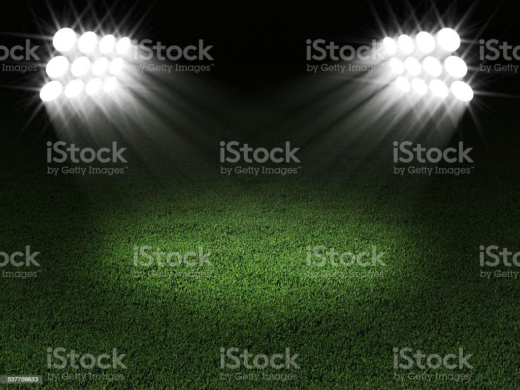 Green Soccer Field Illuminated by Spotlights stock photo