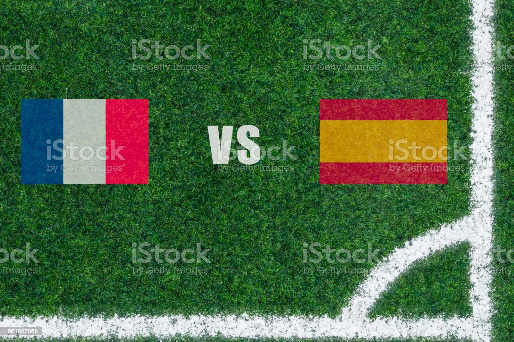 green Soccer Field with white lines and corner. Match France vs Spain. stock photo